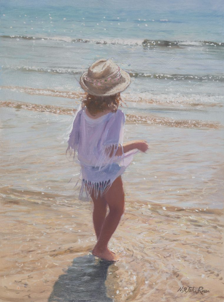 little girl looking forward to step into the sea