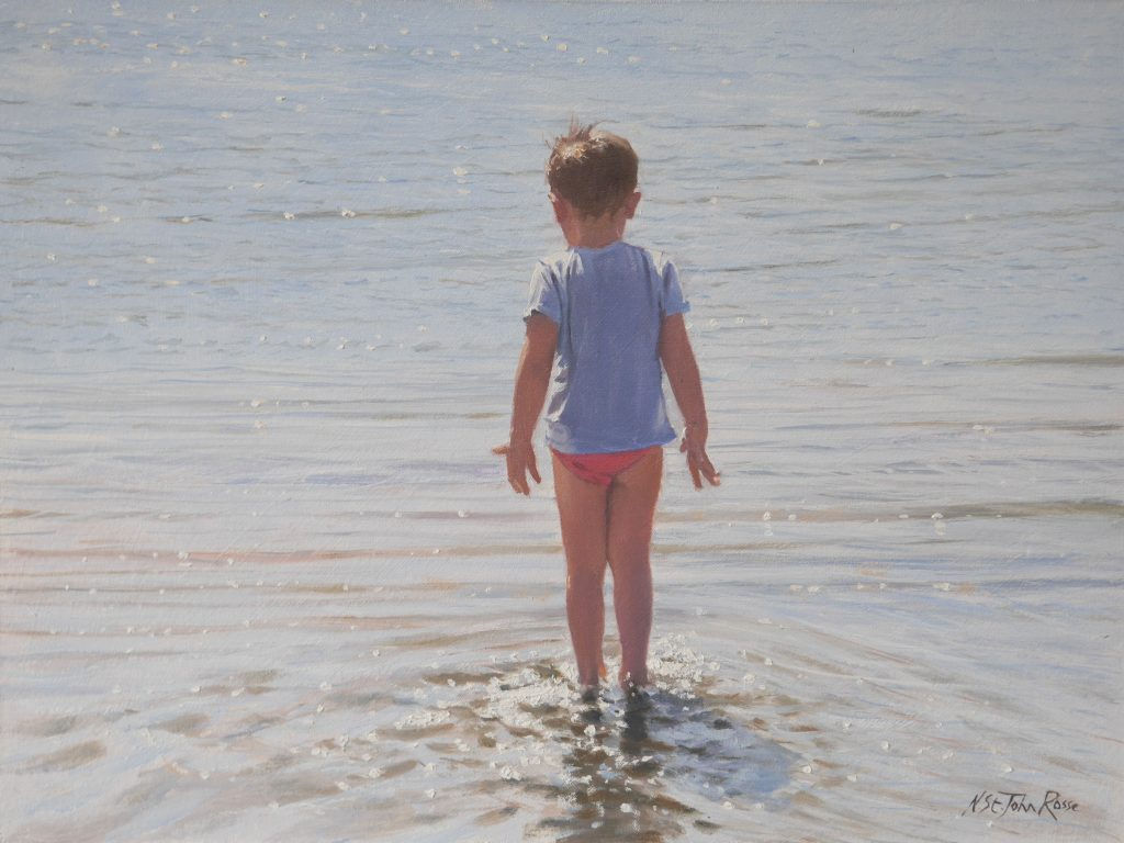 Boy's first steps in the refreshing sea